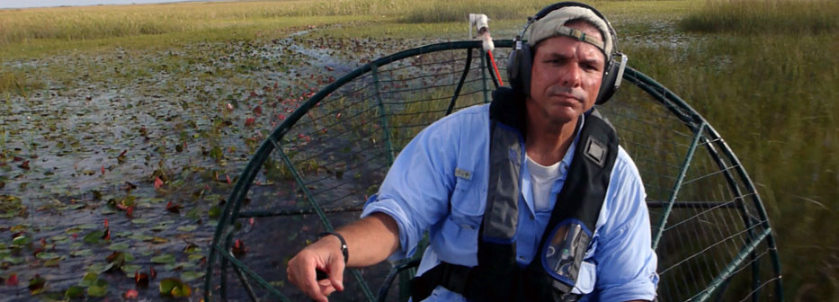 Description: /~trexlerj/Joel_driving_airboat.jpg